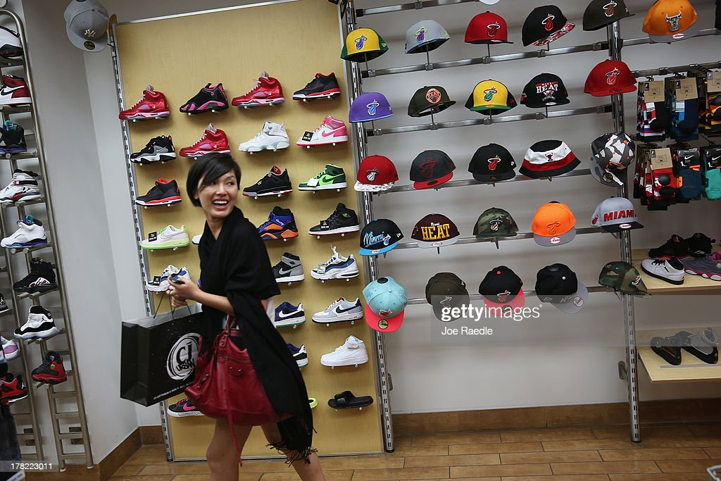Cecilia Chung shops at the C J Urban Wear store on August 27, 2013 in Miami, Florida. The Conference Board announced today that its index of consumer confidence rose to 81.5 this month from a revised 81.0 in July. Some economists reportedly had expected the latest index to edge slightly lower to 79.1.