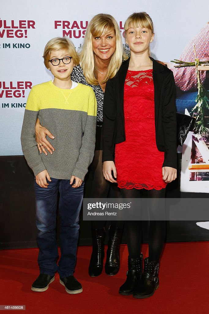 Cecilia Kunz and her kids Gretchen Wortmann and Hugo Wortmann attend the premiere of the film 'Frau Mueller muss weg' at Cinedom on January 12, 2015 in Cologne, Germany.
