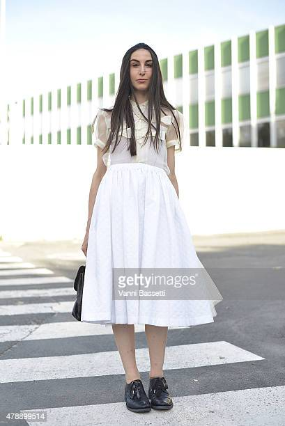 Cecilia Musmeci poses wearing a Comme des Garcons shirt Paul Harnden skirt and A1923 shoes on June 28 2015 in Paris France
