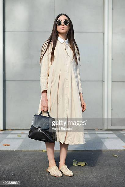 Cecilia Musmeci poses wearing a Sark Studio dress Cherevichkiotvichki bag Kuboraum sunnies and CYDWOQ shoes before the Lea Peckre show at the...