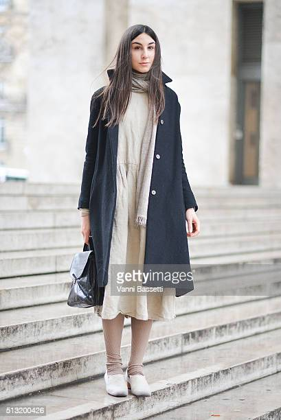 Cecilia Musmeci poses wearing an A1923 coat Alice Wease dress Nehera bag and Cherevitchkiotvchki before the Anrealage show at the Palais de Tokyo...