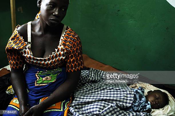 Cecilia Nakabu sits by her 4 month old daughter Jennifer Mansua who has been infected with malaria September 18 2007 in the Kintampo Health Center in...