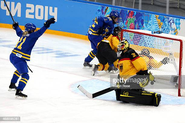Cecilia Osterberg of Sweden celebrates scoring the second goal against Jennifer Harss of Germany in the third period during the Women's Ice Hockey...