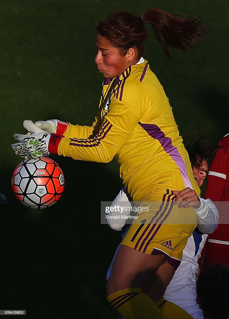 Cecilia Santiago of Mexico makes a save in front of Karina Socarras of Puerto Rico during 2016 CONCACAF Women's Olympic Qualifying at Toyota Stadium...