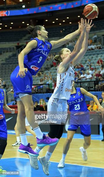 Cecilia Zandalasini of Italy and Emma Meesseman of Belgium jump after a ball during the FIBA EuroBasket 2017 women's quarterfinal match between...