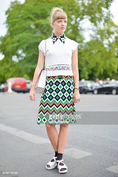 Cecilie Lindegaard poses wearing a vintage dress before the Chanel show at the Grand Palais on July 7 2015 in Paris France
