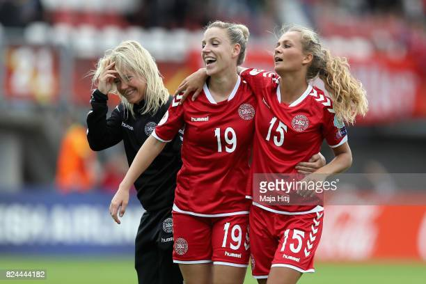 Cecilie Sandvej of Denmark and Sara DoorsounKhajeh of Germany celebrate victory after the UEFA Women's Euro 2017 Quarter Final match between Germany...
