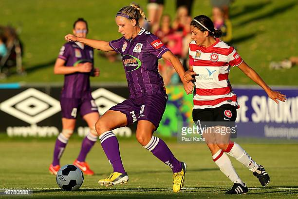 Cecilie Sandvej of the Glory and Catherine Cannuli of the Wanderers contest for the ball during the round 12 WLeague match between the Perth Glory...