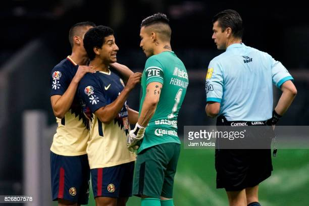 Cecilio Dominguez of America argues with Alfredo Saldivar of Pumas during the 3rd round match between America and Pumas UNAM as part of the Torneo...