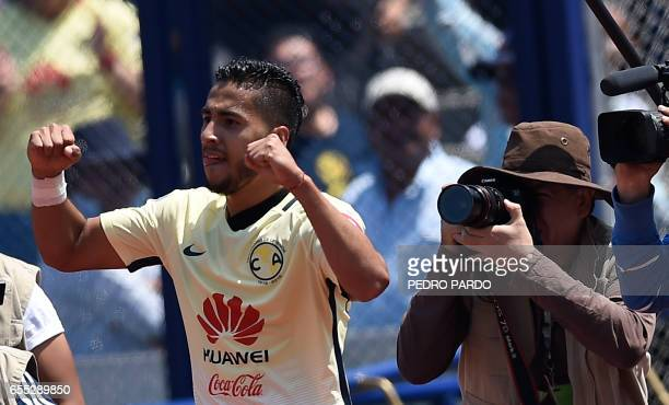 Cecilio Dominguez of America celebrates his goal against the Pumas during their Mexican Clausura football tournament match at the Olympic stadium in...