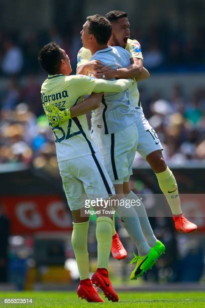 Cecilio Dominguez of America celebrates with teammate after scoring the third goal during the 11st round match between Pumas UNAM and America as par...