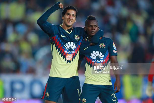 Cecilio Dominguez of America celebrates with teammate Darwin Quintero of America after scoring the second goal of his team during the 2nd round match...