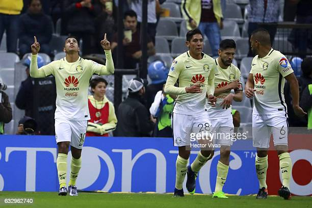 Cecilio Dominguez of America celebrates with teammates after scoring the first goal of his team during the 4th round match between America and...
