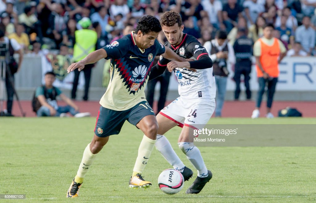 Cecilio Dominguez of America competes for the ball with Rodrigo Godinez of Lobos BUAP during the fifth round match between Lobos BUAP and America as part of the Torneo Apertura 2017 Liga MX at Olimpico de la BUAP Stadium on August 19, 2017 in Puebla, Mexico.