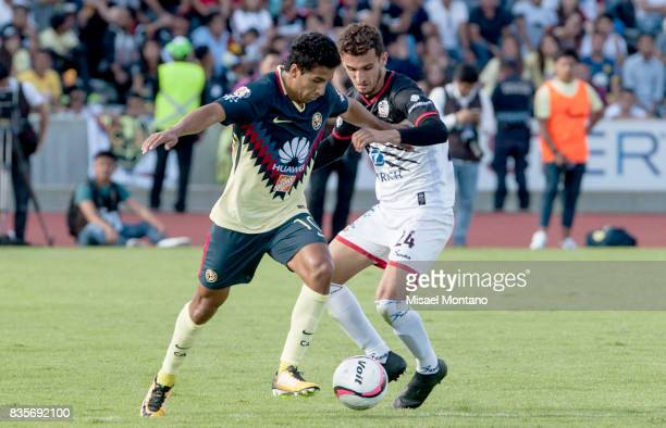 Cecilio Dominguez of America competes for the ball with Rodrigo Godinez of Lobos BUAP during the fifth round match between Lobos BUAP and America as...