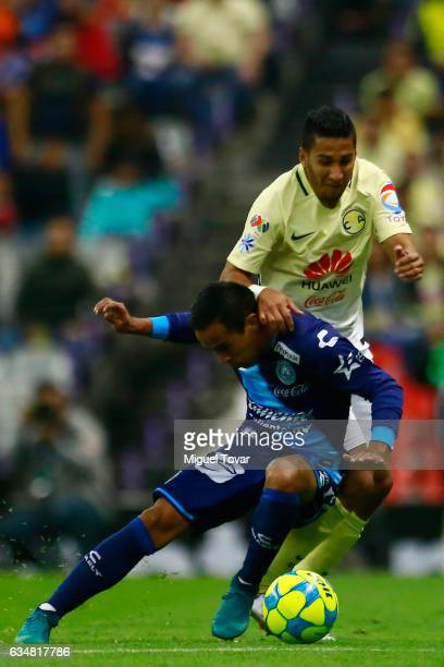 Cecilio Domi'nguez of America fights for the ball with Francisco Torres of Puebla during the 6th round match between America and Puebla as part of...