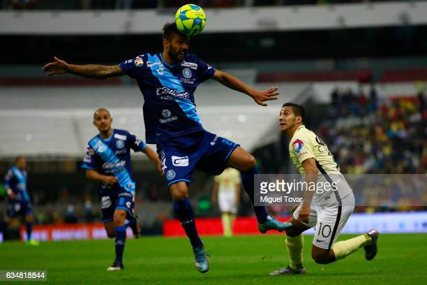 Cecilio Domi'nguez of America fights for the ball with Robert Herrera of Puebla during the 6th round match between America and Puebla as part of the...