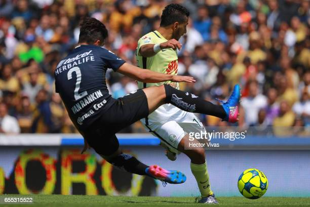 Cecilio Dominguez of America kicks the ball to score the third goal of his team during the 11th round match between Pumas UNAM and America as part of...
