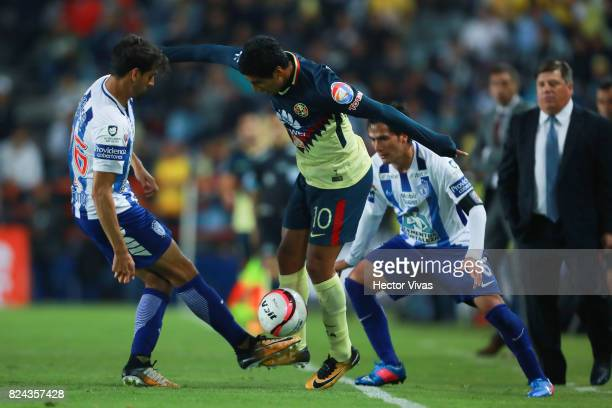 Cecilio Dominguez of America struggles for the ball with Raul Lopez of Pachuca during the 2nd round match between Pachuca and America as part of the...