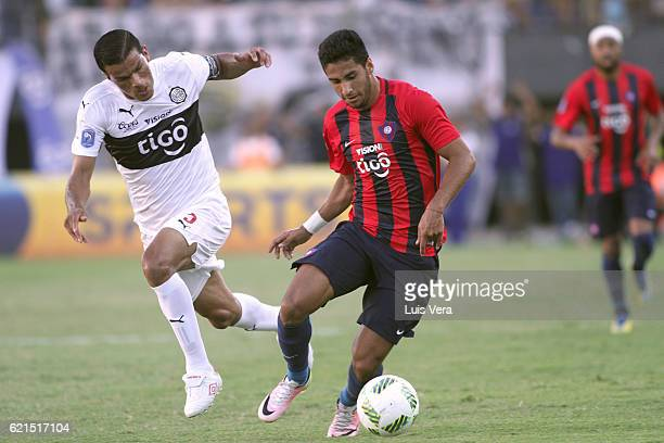 Cecilio Dominguez of Cerro Porteño and Salustiano Candia of Olimpia fight for the ball during a match between Olimpia and Cerro Porteño as part of...