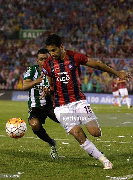 Cecilio Dominguez of Cerro Porteño fights for the ball with Farid Diaz of Atletico Nacional during a first leg match between Cerro Porteño and...