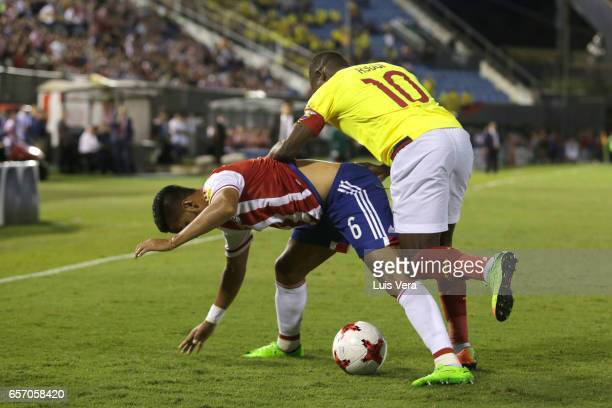 Cecilio Dominguez of Paraguay fights for the ball with Walter Ayovi of Ecuador during a match between Paraguay and Ecuador as part of FIFA 2018 World...