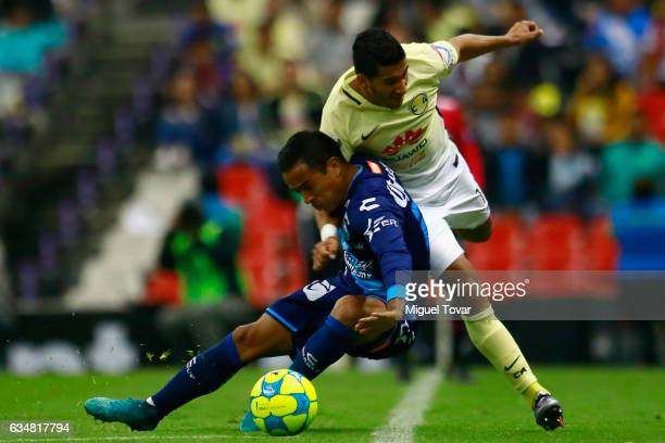 Cecilio Dom'nguez of America fights for the ball with Francisco Torres of Puebla during the 6th round match between America and Puebla as part of the...