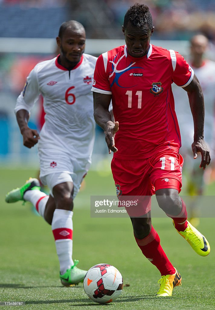 Cecilio Waterman #11 of Panama dribbles the ball past Julian De Guzman #6 of Canada during the second half of a CONCACAF Gold Cup match at Sports Authority Field at Mile High on July 14, 2013 in Denver, Colorado. Canada and Panama played to a 0-0 draw.