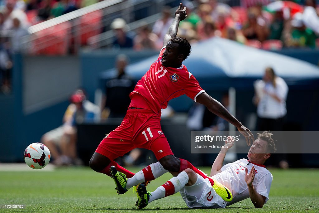 Cecilio Waterman #11 of Panama gets tangled up with <a gi-track='captionPersonalityLinkClicked' href=/galleries/search?phrase=Nikolas+Ledgerwood&family=editorial&specificpeople=787689 ng-click='$event.stopPropagation()'>Nikolas Ledgerwood</a> #2 of Canada while battling for the ball during the second half of a CONCACAF Gold Cup match at Sports Authority Field at Mile High on July 14, 2013 in Denver, Colorado. Canada and Panama played to a 0-0 draw.