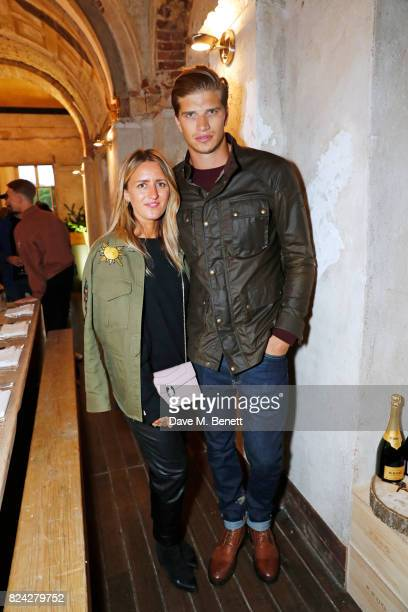 Cecily Brown and Toby HuntingtonWhiteley attend Krug Festival 'Into The Wild' at The Grange Hampshire on July 29 2017 in Northington United Kingdom