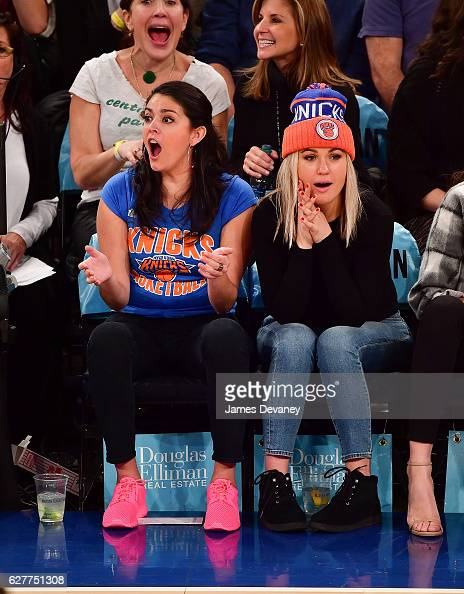 Cecily Strong and guest attend Sacramento Kings vs New York Knicks game at Madison Square Garden on December 4 2016 in New York City