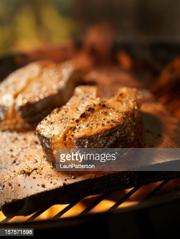 Cedar Plank Salmon Steaks on an outdoor BBQ