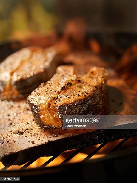 Cedar Plank Salmon Steaks on an outdoor BBQ