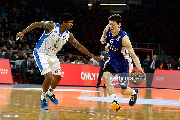 Cedi Osman #6 of Anadolu Efes Istanbul competes with Edgar Sosa #4 of Dinamo Banco di Sardegna Sassari during the 20142015 Turkish Airlines...
