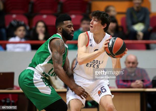 Cedi Osman #6 of Anadolu Efes Istanbul competes with Keith Langford #5 of Unics Kazan during the 2016/2017 Turkish Airlines EuroLeague Regular Season...