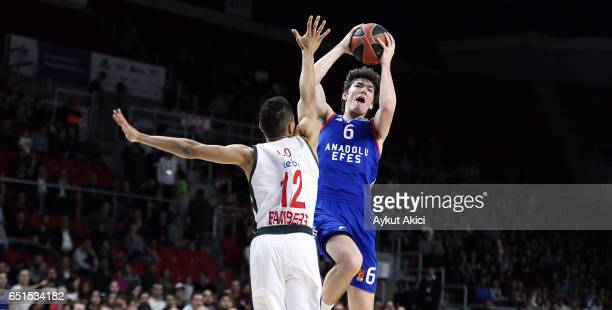 Cedi Osman #6 of Anadolu Efes Istanbul competes with Maodo Lo #12 of Brose Bamberg during the 2016/2017 Turkish Airlines EuroLeague Regular Season...