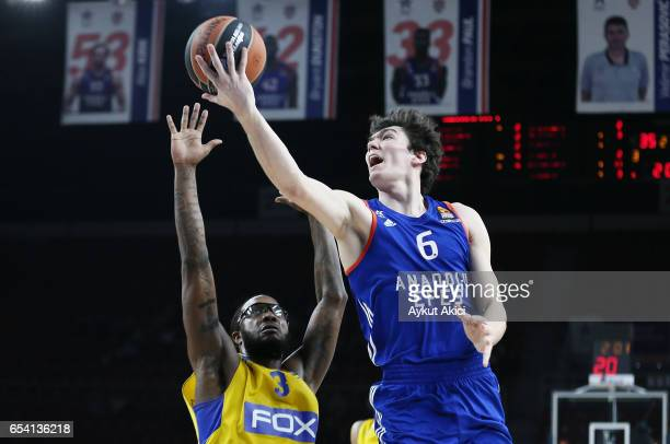 Cedi Osman #6 of Anadolu Efes Istanbul competes with Victor Rudd #3 of Maccabi Fox Tel Aviv during the 2016/2017 Turkish Airlines EuroLeague Regular...