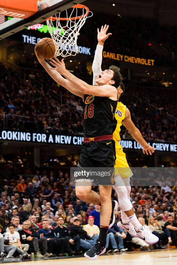 Cedi Osman #16 of the Cleveland Cavaliers shoots over Josh Hart #5 of the Los Angeles Lakers during the second half at Quicken Loans Arena on December 14, 2017 in Cleveland, Ohio. The Cavaliers defeated the Lakers 121-112.