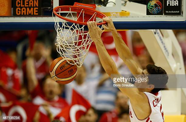 Cedi Osman of Turkey dunks the ball during the FIBA EuroBasket 2015 Group B basketball match between Turkey and Spain at Arena of EuroBasket 2015 on...