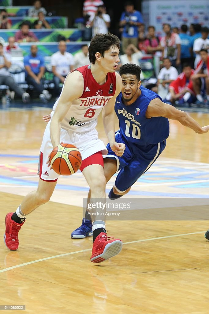 Cedi Osman (L) of Turkey in action during a friendly match between Philippines and Turkey friendly match at Mall of Asia Arena (MOA) in Pasay, Philippines on July 01, 2016.