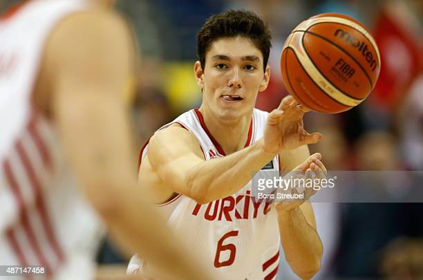Cedi Osman of Turkey passes the ball during the FIBA EuroBasket 2015 Group B basketball match between Turkey and Spain at Arena of EuroBasket 2015 on...