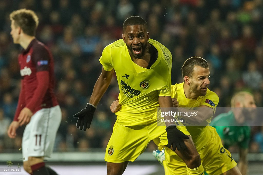 <a gi-track='captionPersonalityLinkClicked' href=/galleries/search?phrase=Cedric+Bakambu&family=editorial&specificpeople=7119714 ng-click='$event.stopPropagation()'>Cedric Bakambu</a> (L) of Villareal celebrates his goal with <a gi-track='captionPersonalityLinkClicked' href=/galleries/search?phrase=Roberto+Soldado&family=editorial&specificpeople=2095686 ng-click='$event.stopPropagation()'>Roberto Soldado</a> during the UEFA Europa League Quarter Final second leg match between Sparta Prague and Villareal CF on April 14, 2016 in Prague, Czech Republic.