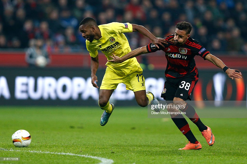 Cedric Bakambu of Villarreal and Karim Bellarabi of Bayer Leverkusen battle for the ball during the UEFA Europa League round of 16, second leg match between Bayer Leverkusen and Villarreal CF at Bay Arena on March 17, 2016 in Leverkusen, Germany.