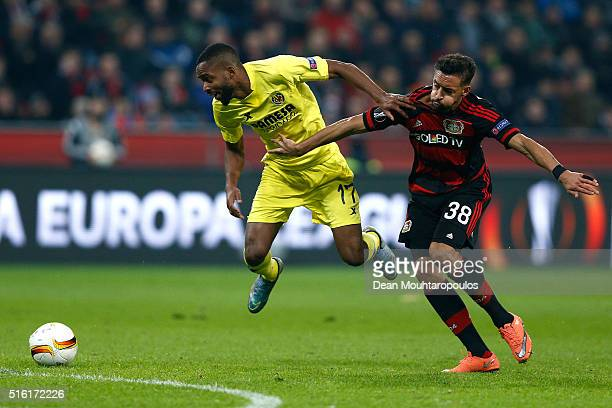 Cedric Bakambu of Villarreal and Karim Bellarabi of Bayer Leverkusen battle for the ball during the UEFA Europa League round of 16 second leg match...