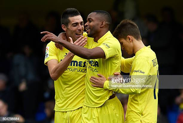 Cedric Bakambu of Villarreal celebrates scoring his team's second goal with his teammates Bruno Soriano and Denis Suarez during the La Liga match...