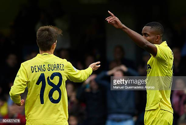 Cedric Bakambu of Villarreal celebrates scoring his team's second goal with his teammate Denis Suarez during the La Liga match between Villarreal CF...