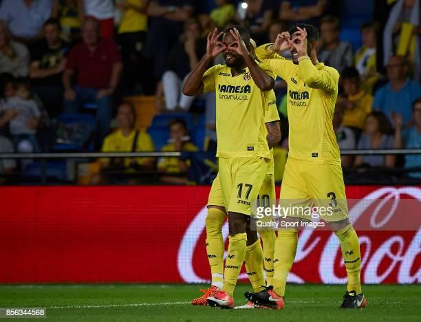 Cedric Bakambu of Villarreal celebrates with his teammates after scoring a goal the La Liga match between Villarreal and Eibar at Estadio De La...