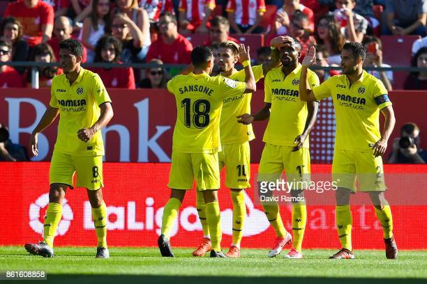 Cedric Bakambu of Villarreal CF celebrates with his team mates after scoring his team's second goalduring the La Liga match between Girona and...