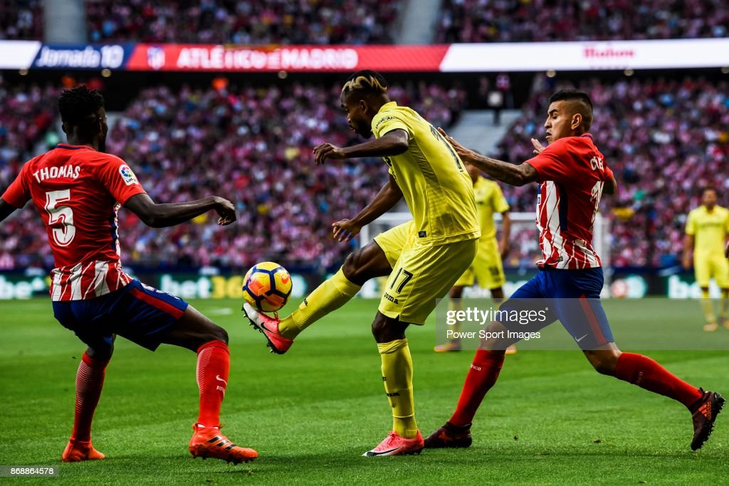 Cedric Bakambu (c) of Villarreal CF competes for the ball with Thomas Teye Partey (l) and Angel Correa of Atletico de Madrid during the La Liga 2017-18 match between Atletico de Madrid and Villarreal CF at Wanda Metropolitano on October 28 2017 in Madrid, Spain.