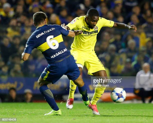 Cedric Bakambu of Villarreal CF fights for the ball with Lisandro Magallan of Boca Juniors during the international friendly match between Boca...